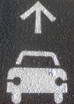 One way arrow and car on pavement photo by Tony Kovach