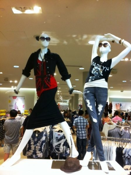 mannequins in busy mall retail store