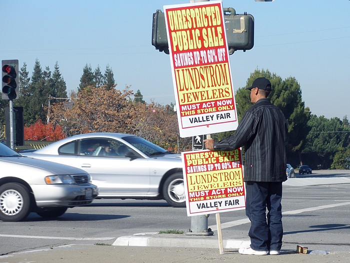 ad-sign-man-credit-wikicommons-posted-cutting-edge-blog-mhpronews-com-