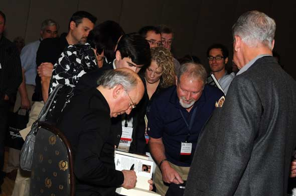 Jim Clayton signs his book for attendees, MHI Congress and Expo 2010, Photo courtesy MHI, Lisa Stewart Photography